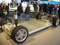 Tesla Model S,  lithium-ion battery chassis with suspension, powertrain, and wheels